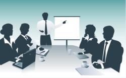 Grupo en sala de reuniones.png