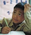 Niño escribe en cuaderno.png
